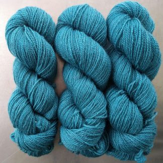 Semi-solid turquoise, with sea blue and grey tones Bluefaced Leicester (BFL) / Gotland 4-ply (fingering) yarn. Hand-dyed by Triskelion Yarn