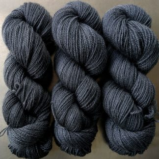 Semi-solid mid to dark grey, with tones of stormy blue and violet Bluefaced Leicester (BFL) / Gotland 4-ply (fingering) yarn. Hand-dyed by Triskelion Yarn