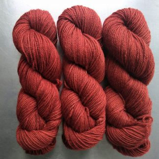 Cofgodas - Semi-solid dark orange, with tones of copper, vermillion and russet Bluefaced Leicester (BFL) / Gotland dlouble knit (DK) yarn. Hand-dyed by Triskelion Yarn