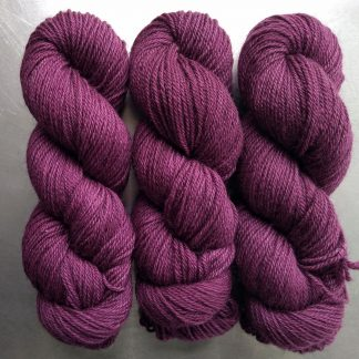 Damson - Mid-tone violet red Bluefaced Leicester (BFL) / Gotland dlouble knit (DK) yarn. Hand-dyed by Triskelion Yarn