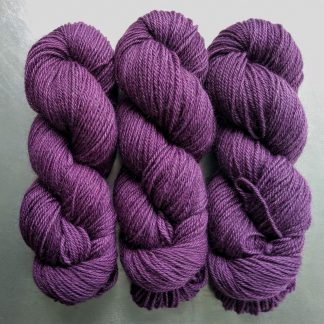 Ring Giver - Semi-solid dark purple, with red-violet and royal purple tones Bluefaced Leicester (BFL) / Gotland dlouble knit (DK) yarn. Hand-dyed by Triskelion Yarn