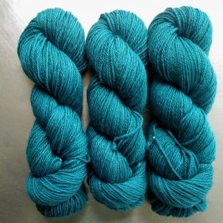 Tarn - Semi-solid turquoise, with sea blue and grey tones Bluefaced Leicester (BFL) / Gotland dlouble knit (DK) yarn. Hand-dyed by Triskelion Yarn