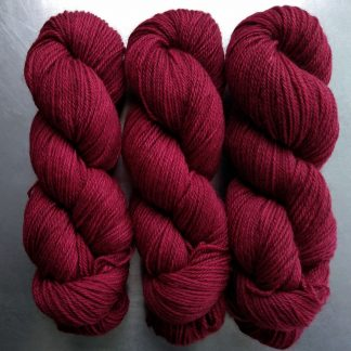 Wyrd - Deep red Bluefaced Leicester (BFL) / Gotland dlouble knit (DK) yarn. Hand-dyed by Triskelion Yarn