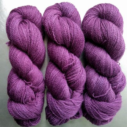 Brennin - Reddish royal purple Falklands Corriedale and British Mohair 4-ply/fingering/sock yarn. Hand-dyed by Triskelion Yarn