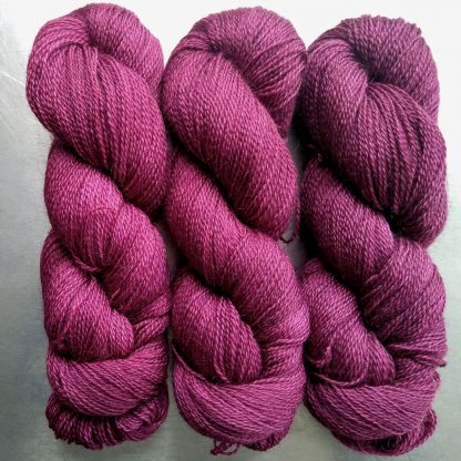 Malwen - Deep Tyrian red-purple Falklands Corriedale and British Mohair 4-ply/fingering/sock yarn. Hand-dyed by Triskelion Yarn