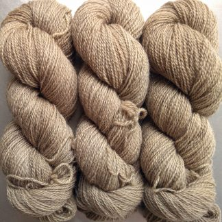 Almond - Warm beige-brown Bluefaced Leicester (BFL) / Gotland 4-ply (fingering) yarn. Hand-dyed by Triskelion Yarn