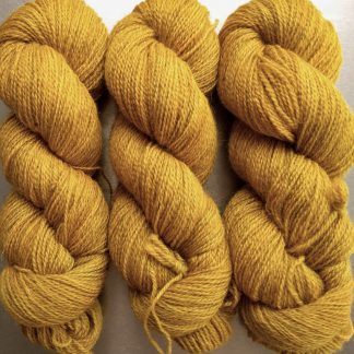 Heaven's Gem - Rich imperial yellow Bluefaced Leicester (BFL) / Gotland 4-ply (fingering) yarn. Hand-dyed by Triskelion Yarn