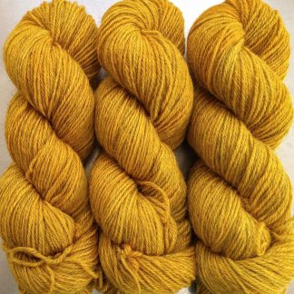 Heaven's Gem - Rich imperial yellow Bluefaced Leicester (BFL) / Gotland dlouble knit (DK) yarn. Hand-dyed by Triskelion Yarn