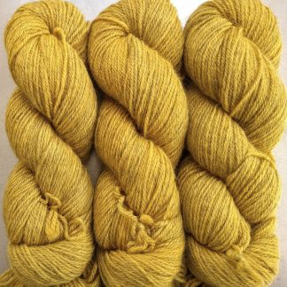 Otter's Cairn - Semi-solid yellow, with tones of ochre and antique gold Bluefaced Leicester (BFL) / Gotland dlouble knit (DK) yarn. Hand-dyed by Triskelion Yarn