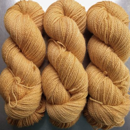Apricot - light apricot orange Bluefaced Leicester / silk 4-ply yarn. Hand-dyed by Triskelion Yarn.