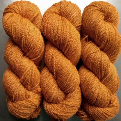 Bonfire - mid-tone fiery orange Bluefaced Leicester / silk 4-ply yarn. Hand-dyed by Triskelion Yarn.