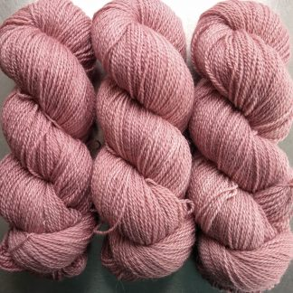Mallow - soft pale pink Bluefaced Leicester / silk 4-ply yarn. Hand-dyed by Triskelion Yarn.