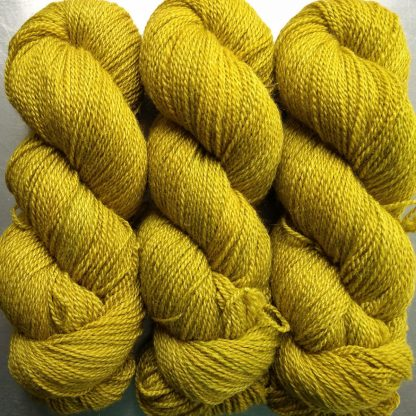 Quince - light greenish yellow Bluefaced Leicester / silk 4-ply yarn. Hand-dyed by Triskelion Yarn.