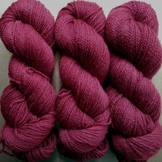 Red Pear - dark purplish red Bluefaced Leicester / silk 4-ply yarn. Hand-dyed by Triskelion Yarn.