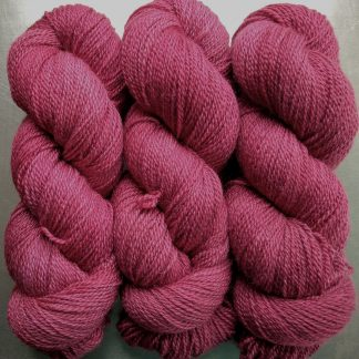 Rose - vibrant deep rose Bluefaced Leicester / silk 4-ply yarn. Hand-dyed by Triskelion Yarn.
