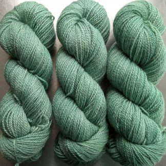 Surf - pale bluish green Bluefaced Leicester / silk 4-ply yarn. Hand-dyed by Triskelion Yarn.