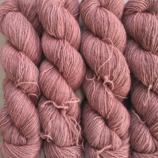 Eostre - Soft pink Bluefaced Leicester (BFL) / Gotland / Wensleydale 4-ply (fingering) weight high-twist sock yarn. Hand-dyed by Triskelion Yarn