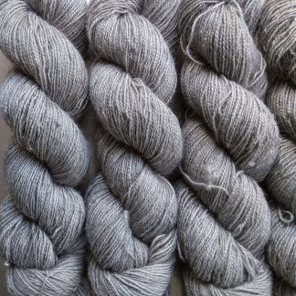 Fog - Soft light grey Bluefaced Leicester (BFL) / Gotland / Wensleydale 4-ply (fingering) weight high-twist sock yarn. Hand-dyed by Triskelion Yarn