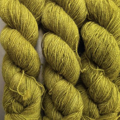 Frea - Light chartreuse green Bluefaced Leicester (BFL) / Gotland / Wensleydale 4-ply (fingering) weight high-twist sock yarn. Hand-dyed by Triskelion Yarn