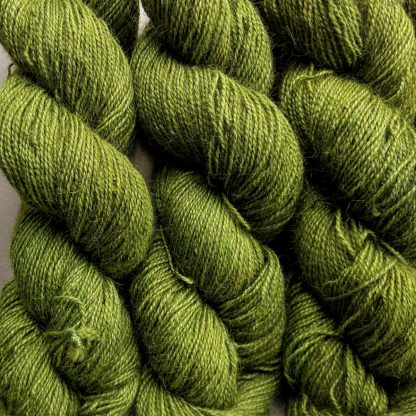 Gerda - Mid tone grassy green Bluefaced Leicester (BFL) / Gotland / Wensleydale 4-ply (fingering) weight high-twist sock yarn. Hand-dyed by Triskelion Yarn