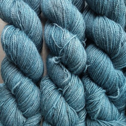 Hama's Hall - Light grey-blue Bluefaced Leicester (BFL) / Gotland / Wensleydale 4-ply (fingering) weight high-twist sock yarn. Hand-dyed by Triskelion Yarn