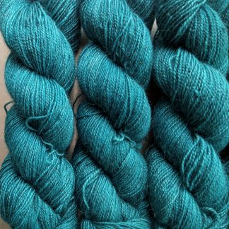 Harbour - Dark turquoise Bluefaced Leicester (BFL) / Gotland / Wensleydale 4-ply (fingering) weight high-twist sock yarn. Hand-dyed by Triskelion Yarn