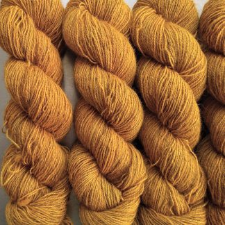 Heaven's Gem - Rich imperial yellow Bluefaced Leicester (BFL) / Gotland / Wensleydale 4-ply (fingering) weight high-twist sock yarn. Hand-dyed by Triskelion Yarn