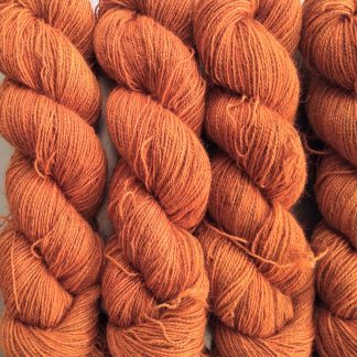 Mound Fire - Warm mid-tone orange Bluefaced Leicester (BFL) / Gotland / Wensleydale 4-ply (fingering) weight high-twist sock yarn. Hand-dyed by Triskelion Yarn