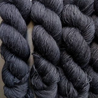 Night - Soft black Bluefaced Leicester (BFL) / Gotland / Wensleydale 4-ply (fingering) weight high-twist sock yarn. Hand-dyed by Triskelion Yarn