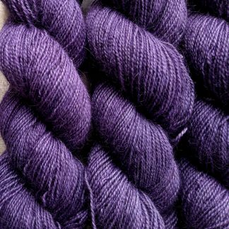 Peace Weaver - Soft mid-tone blue-violet Bluefaced Leicester (BFL) / Gotland / Wensleydale 4-ply (fingering) weight high-twist sock yarn. Hand-dyed by Triskelion Yarn