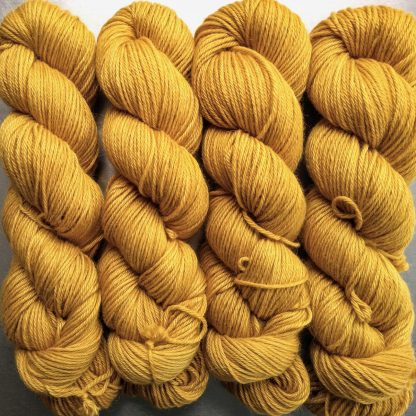 Heaven's Gem - Rich imperial yellow Baby Alpaca Silk & Cashmere double-knit yarn. Hand-dyed by Triskelion Yarn.