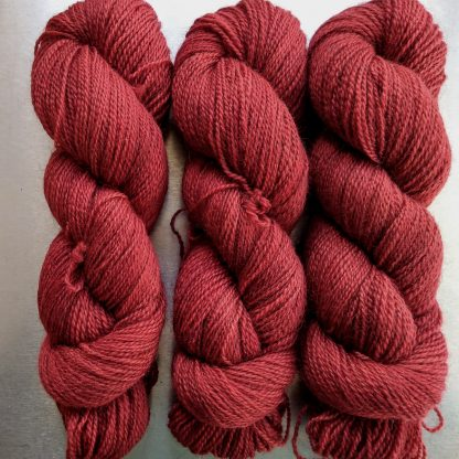 Dark Poppy - Deep scarlet red Bluefaced Leicester (BFL) / Gotland 4-ply (fingering) yarn. Hand-dyed by Triskelion Yarn