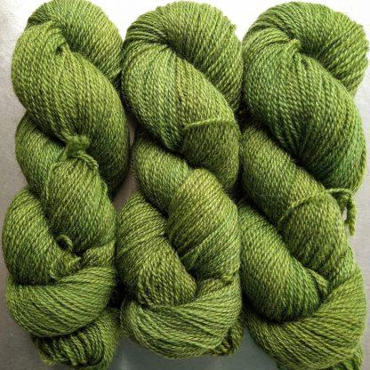 Gerda - Mid tone grassy green Bluefaced Leicester (BFL) / Gotland 4-ply (fingering) yarn. Hand-dyed by Triskelion Yarn