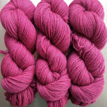 Yves Rose - Intense mid to dark rose Bluefaced Leicester (BFL) / Gotland 4-ply (fingering) yarn. Hand-dyed by Triskelion Yarn