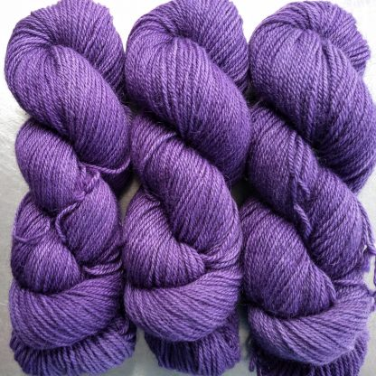 Saxnot - Semi-solid mid-tone purple Bluefaced Leicester (BFL) / Gotland dlouble knit (DK) yarn. Hand-dyed by Triskelion Yarn