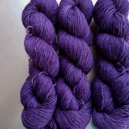 Saxnot - Semi-solid mid-tone purple Bluefaced Leicester (BFL) / Gotland / Wensleydale 4-ply (fingering) weight high-twist sock yarn. Hand-dyed by Triskelion Yarn