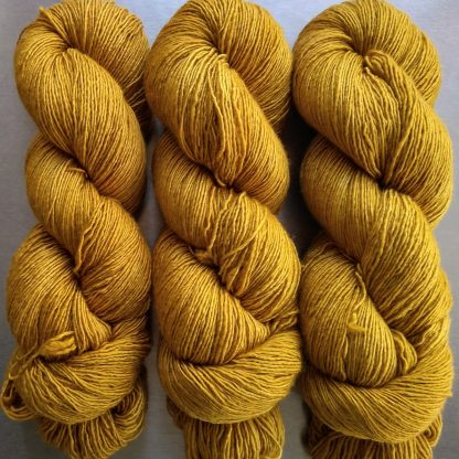 Ochre - Earthy golden yellow Falklands Merino and silk blend yarn. Hand-dyed by Triskelion Yarn.