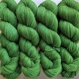 Afallon - Mid-tone green with gold undertone Baby Alpaca Silk & Cashmere double-knit yarn. Hand-dyed by Triskelion Yarn.