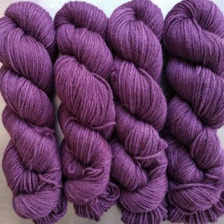 Tyrian Purple - Reddish purple Baby Alpaca Silk & Cashmere double-knit yarn. Hand-dyed by Triskelion Yarn.