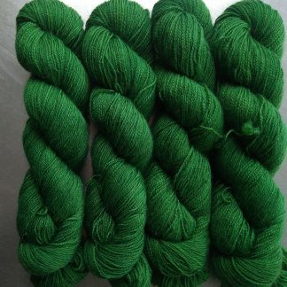 Nemeton - Mid-tone emerald green Bluefaced Leicester (BFL) / Gotland / Wensleydale 4-ply (fingering) weight high-twist sock yarn. Hand-dyed by Triskelion Yarn