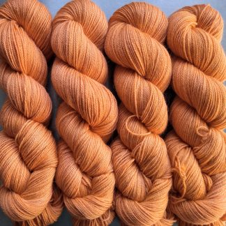 Apricot - Light orange Baby Alpaca Silk & Cashmere 4-ply yarn. Hand-dyed by Triskelion Yarn.