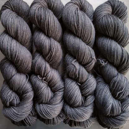 Graphite - Mid to dark grey Baby Alpaca Silk & Cashmere 4-ply yarn. Hand-dyed by Triskelion Yarn.