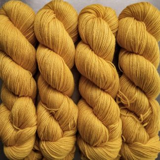 Mango - Warm imperial yellow Baby Alpaca Silk & Cashmere 4-ply yarn. Hand-dyed by Triskelion Yarn.