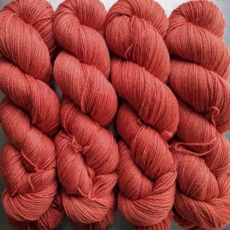 Papaya - Mid-tone coral Baby Alpaca Silk & Cashmere 4-ply yarn. Hand-dyed by Triskelion Yarn.