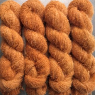 Apricot - Light orange suri alpaca and silk luxury heavy laceweight yarn. Hand-dyed by Triskelion Yarn
