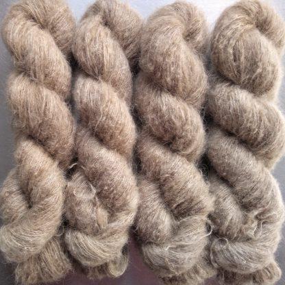 Biscuit - Light brownish beige suri alpaca and silk luxury heavy laceweight yarn. Hand-dyed by Triskelion Yarn