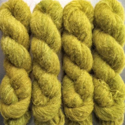 Frea - Light chartreuse green suri alpaca and silk luxury heavy laceweight yarn. Hand-dyed by Triskelion Yarn