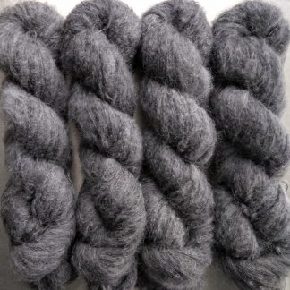 Graphite - Mid to dark grey suri alpaca and silk luxury heavy laceweight yarn. Hand-dyed by Triskelion Yarn