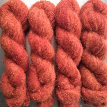 Papaya - Mid-tone coral suri alpaca and silk luxury heavy laceweight yarn. Hand-dyed by Triskelion Yarn