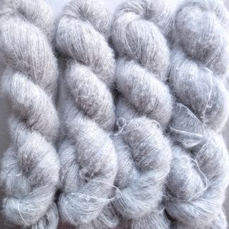 Silver - Pale silver-grey suri alpaca and silk luxury heavy laceweight yarn. Hand-dyed by Triskelion Yarn